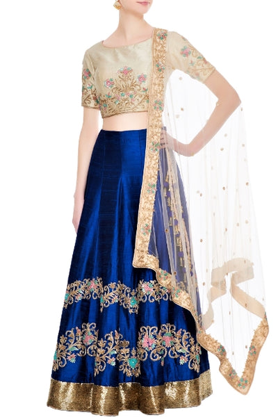 Buy royal blue embroidered lehenga online in USA with beige blouse. Give a touch of elegance to your style with an exclusive range of Indian dresses, designer lehengas from Pure Elegance Indian fashion store in USA or shop online.-full view