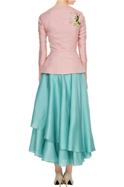 Buy pastel blue layered skirt online in USA with dusty pink embroidered peplum top. Give a touch of elegance to your style with an exclusive range of Indian formal dresses, designer lehengas, Indowestern dresses from Pure Elegance Indian fashion store in USA or shop online.-back