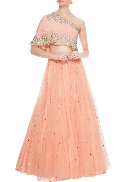 Buy peach net layered lehenga online in USA with embroidered one shoulder blouse. Add a flavor of glamor with an exclusive range of Indian formal dresses, designer lehengas, Indowestern dresses from Pure Elegance Indian fashion store in USA or shop online.-full view