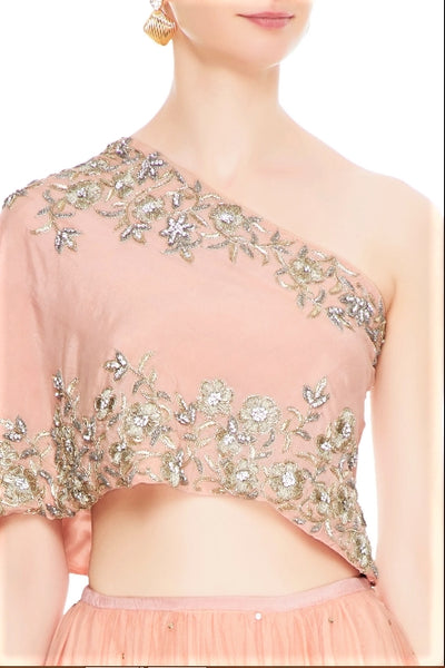Buy peach net layered lehenga online in USA with embroidered one shoulder blouse. Add a flavor of glamor with an exclusive range of Indian formal dresses, designer lehengas, Indowestern dresses from Pure Elegance Indian fashion store in USA or shop online.-top