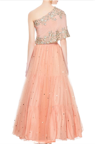 Buy peach net layered lehenga online in USA with embroidered one shoulder blouse. Add a flavor of glamor with an exclusive range of Indian formal dresses, designer lehengas, Indowestern dresses from Pure Elegance Indian fashion store in USA or shop online.-back
