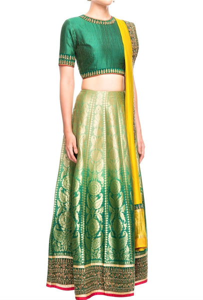 Buy ombre green Banarasi lehenga online in USA with yellow dupatta. Bring a rich traditional touch to your bridal look with beautiful Indian designer lehengas from Pure Elegance clothing store. We have a range of wedding lehengas, designer sarees, bridal saris in USA online and in our store. Shop now. -full view