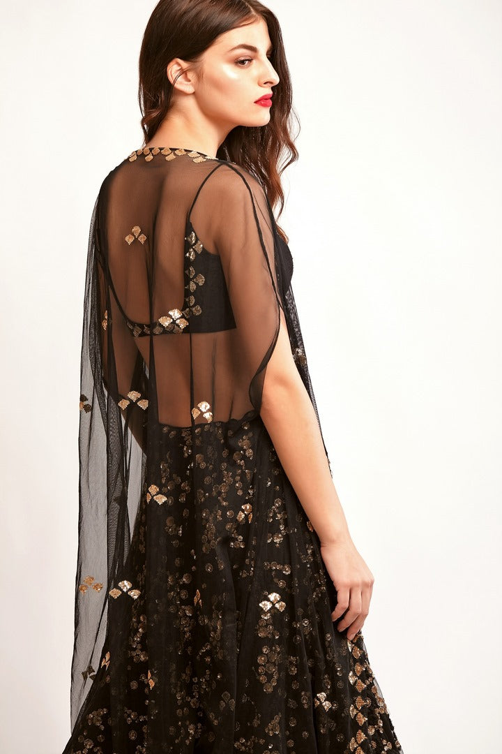 f1482214eced4a Buy black embroidered net lehenga with raw silk strappy blouse online in USA.  You can