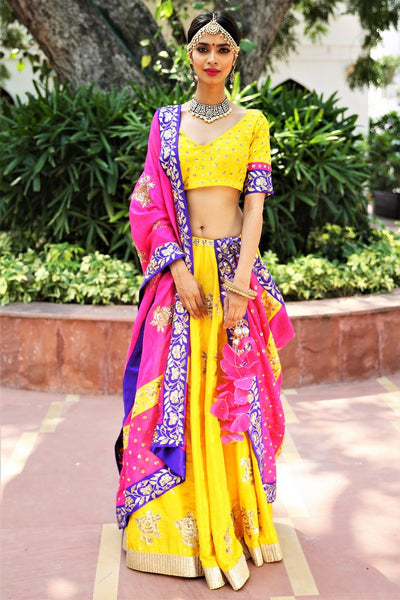 Buy turmeric yellow embroidered dupion lehenga with pink dupatta online in USA. Get wedding ready with a stunning range of Indian designer lehengas from Pure Elegance fashion store in USA. Shop from a collection of silk sarees, wedding sarees, Banarasi sarees, and Indian clothing for a gorgeous ethnic look.-full view