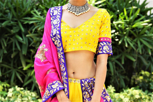 Buy turmeric yellow embroidered dupion lehenga with pink dupatta online in USA. Get wedding ready with a stunning range of Indian designer lehengas from Pure Elegance fashion store in USA. Shop from a collection of silk sarees, wedding sarees, Banarasi sarees, and Indian clothing for a gorgeous ethnic look.-blouse