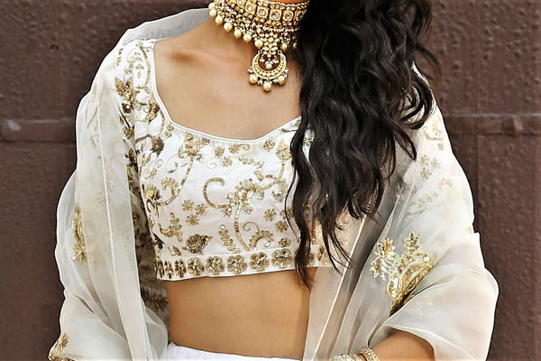 Buy white chanderi silk lehenga with organza silk dupatta online in USA. Get wedding ready with a stunning range of Indian designer lehengas from Pure Elegance fashion store in USA. Shop from a collection of silk sarees, wedding sarees, Banarasi saris, and Indian clothing for a gorgeous ethnic look.-blouse