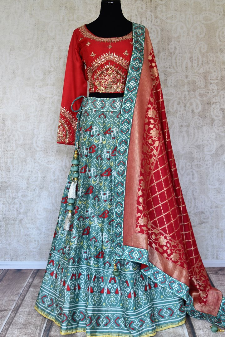 Buy blue and red embroidered ikat silk lehenga with dupatta online in USA from Pure Elegance. Be an epitome of Indian fashion in exquisite Indian designer lehengas, embroidered sarees, Anarkali suits available at our exclusive Indian fashion store in USA and also on our online store. Shop now.-full view