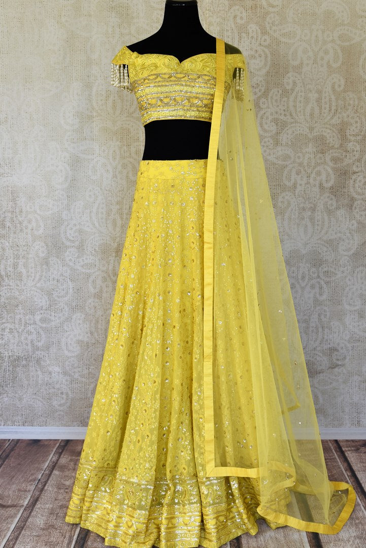Buy lemon yellow embroidered georgette lehenga with dupatta online in USA. Shop more such Indian designer lehengas, designer Indian dresses, wedding dresses in USA from Pure Elegance clothing fashion store this wedding season.-full view