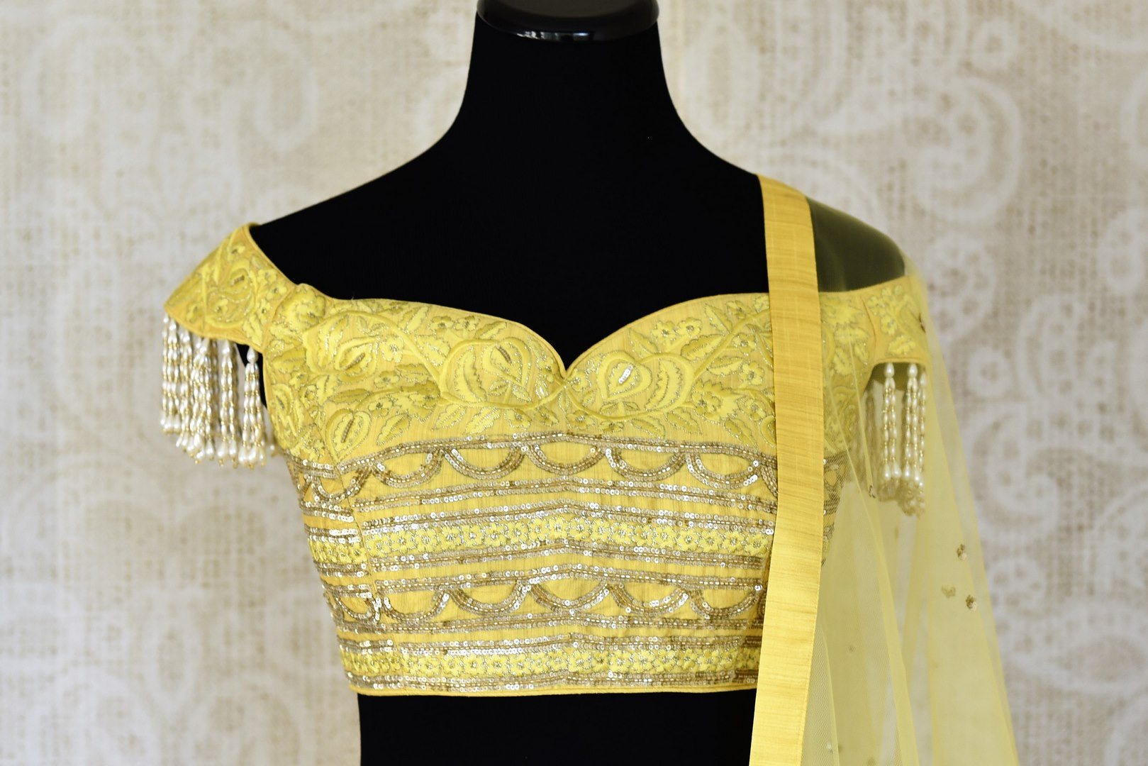 Buy lemon yellow embroidered georgette lehenga with dupatta online in USA. Shop more such Indian designer lehengas, designer Indian dresses, wedding dresses in USA from Pure Elegance clothing fashion store this wedding season.-front