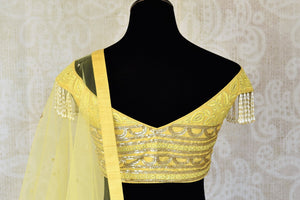 Buy lemon yellow embroidered georgette lehenga with dupatta online in USA. Shop more such Indian designer lehengas, designer Indian dresses, wedding dresses in USA from Pure Elegance clothing fashion store this wedding season.-back