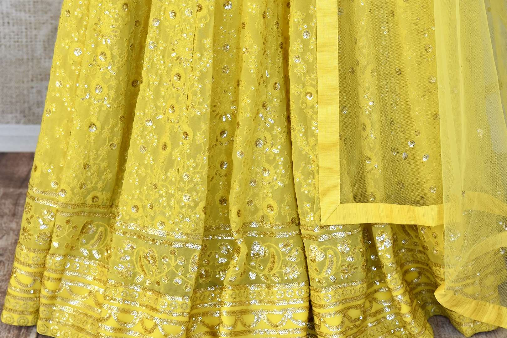 Buy lemon yellow embroidered georgette lehenga with dupatta online in USA. Shop more such Indian designer lehengas, designer Indian dresses, wedding dresses in USA from Pure Elegance clothing fashion store this wedding season.-bottom