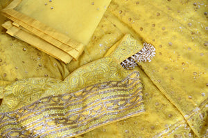 Buy lemon yellow embroidered georgette lehenga with dupatta online in USA. Shop more such Indian designer lehengas, designer Indian dresses, wedding dresses in USA from Pure Elegance clothing fashion store this wedding season.-details