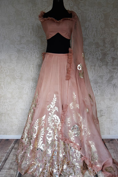 Shop blush pink designer tissue applique work lehenga online in USA. Make your style extraordinary on weddings and special occasions with Indian designer lehenga, traditional dresses, Anarkali suits from Pure Elegance Indian clothing store in USA.-full view