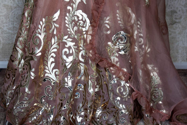 Shop blush pink designer tissue applique work lehenga online in USA. Make your style extraordinary on weddings and special occasions with Indian designer lehenga, traditional dresses, Anarkali suits from Pure Elegance Indian clothing store in USA.-pleats