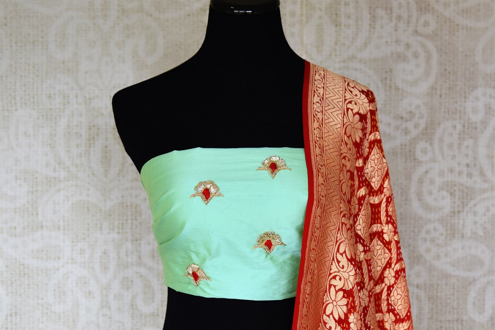 Buy green raw silk lehenga online in USA with gota patti work and red dupatta. Make fashionable choices with latest Indian designer clothing from Pure Elegance Indian fashion store in USA. Shop Indian salwar suits, designer Anarkali suits and bridal lehengas for Indian brides in USA from our online store.-blouse