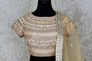 Shop off-white embroidered Lucknowi lehenga online in USA with dupatta. Pick your favorite Indian clothing from a colorful collection available at Pure Elegance Indian fashion store in USA. We have an alluring range of wedding lehengas, designer Anarkali suits, gowns for Indian women in USA.-front