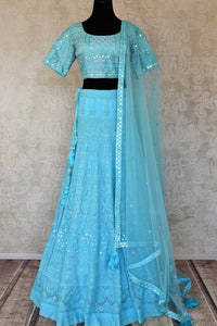Shop turquoise blue Lucknowi lehenga online in USA with dupatta. Keep your wardrobe update with latest Indian designer clothese from Pure Elegance Indian fashion store in USA. Shop traditional Anarkali suits, designer lehengas for Indian brides in USA from our online store.-full view