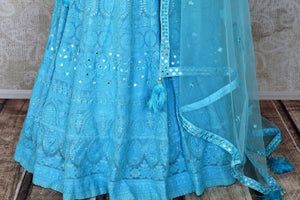 Shop turquoise blue Lucknowi lehenga online in USA with dupatta. Keep your wardrobe update with latest Indian designer clothese from Pure Elegance Indian fashion store in USA. Shop traditional Anarkali suits, designer lehengas for Indian brides in USA from our online store.-bottom