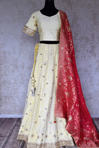 Shop lemon yellow Lucknowi lehenga online in USA with pink dupatta. Make fashionable choices with latest Indian designer clothing from Pure Elegance Indian fashion store in USA. Shop Indian salwar suits, designer Anarkali suits and bridal lehengas for Indian brides in USA from our online store.-full view
