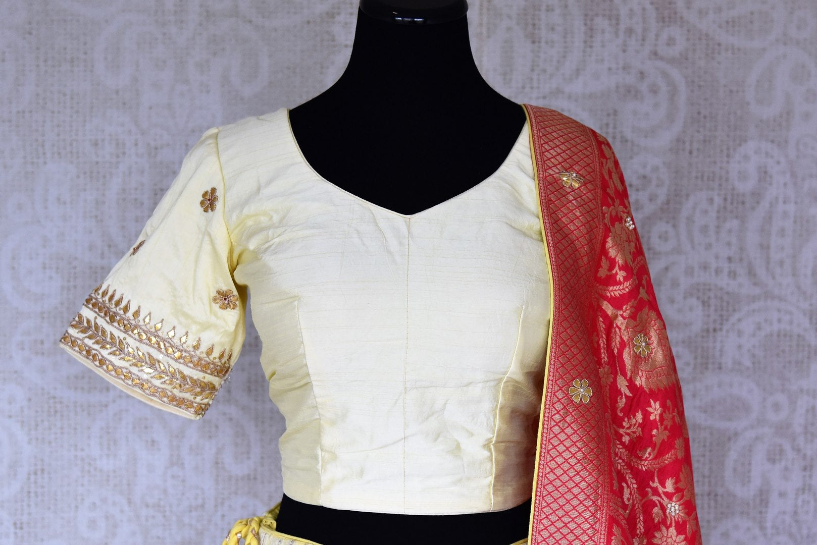 Shop lemon yellow Lucknowi lehenga online in USA with pink dupatta. Make fashionable choices with latest Indian designer clothing from Pure Elegance Indian fashion store in USA. Shop Indian salwar suits, designer Anarkali suits and bridal lehengas for Indian brides in USA from our online store.-front