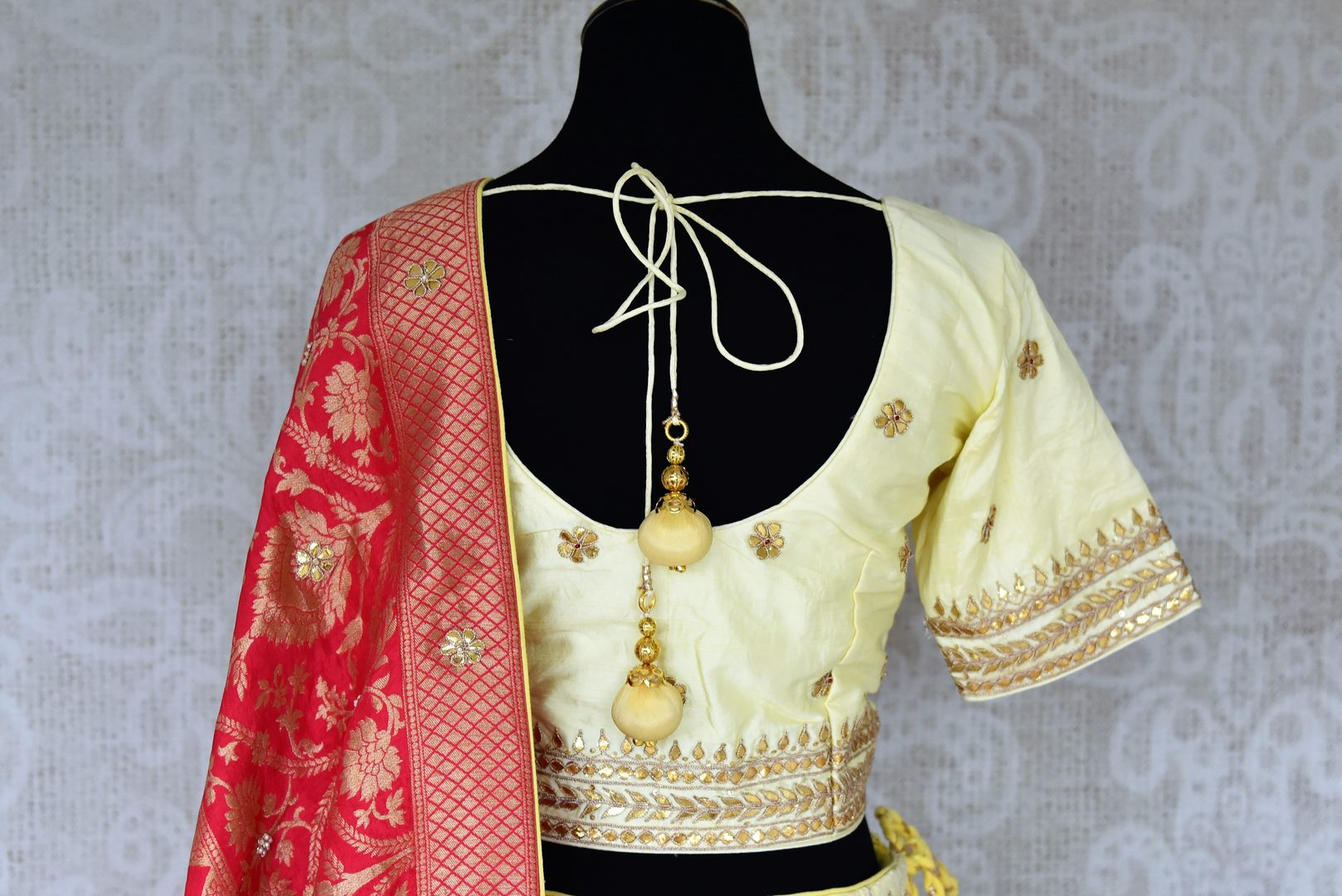 Shop lemon yellow Lucknowi lehenga online in USA with pink dupatta. Make fashionable choices with latest Indian designer clothing from Pure Elegance Indian fashion store in USA. Shop Indian salwar suits, designer Anarkali suits and bridal lehengas for Indian brides in USA from our online store.-back