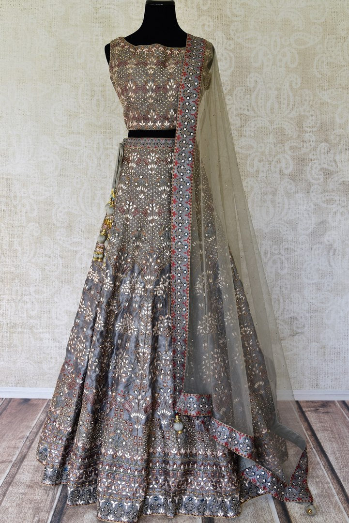 Buy grey gota patti embroidery printed silk lehenga online in USA with dupatta. Update your saree wardrobe with stunning Indian designer clothing from Pure Elegance Indian fashion store in USA. Shop now.-full view