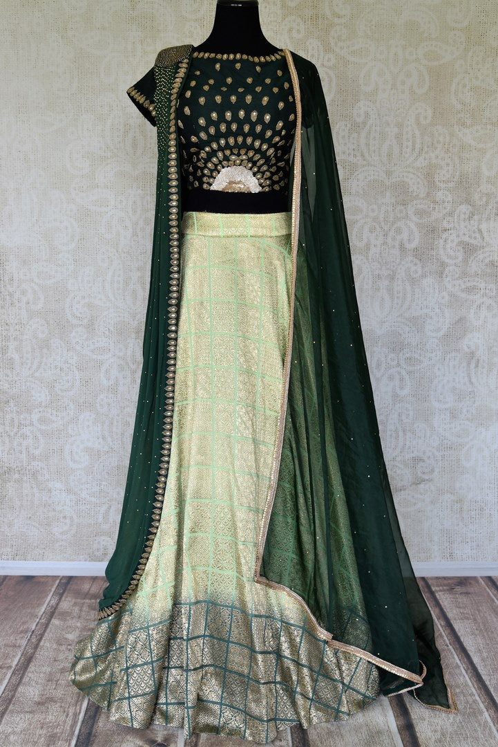 Buy green hand embroidered silk designer lehenga online in USA. Radiate ethnic charm with beautiful Indian designer clothing from Pure Elegance Indian clothing store in USA. Choose from a variety of Anarkali suits, designer Indian suits, designer lehengas for special occasions.-full view