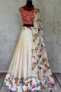 Buy cream and red floral print hand embroidered silk lehenga online in USA with dupatta. Step up your ethnic fashion game with exquisite variety of designer lehengas from Pure Elegance Indian clothing store in USA. Shop online.-full view
