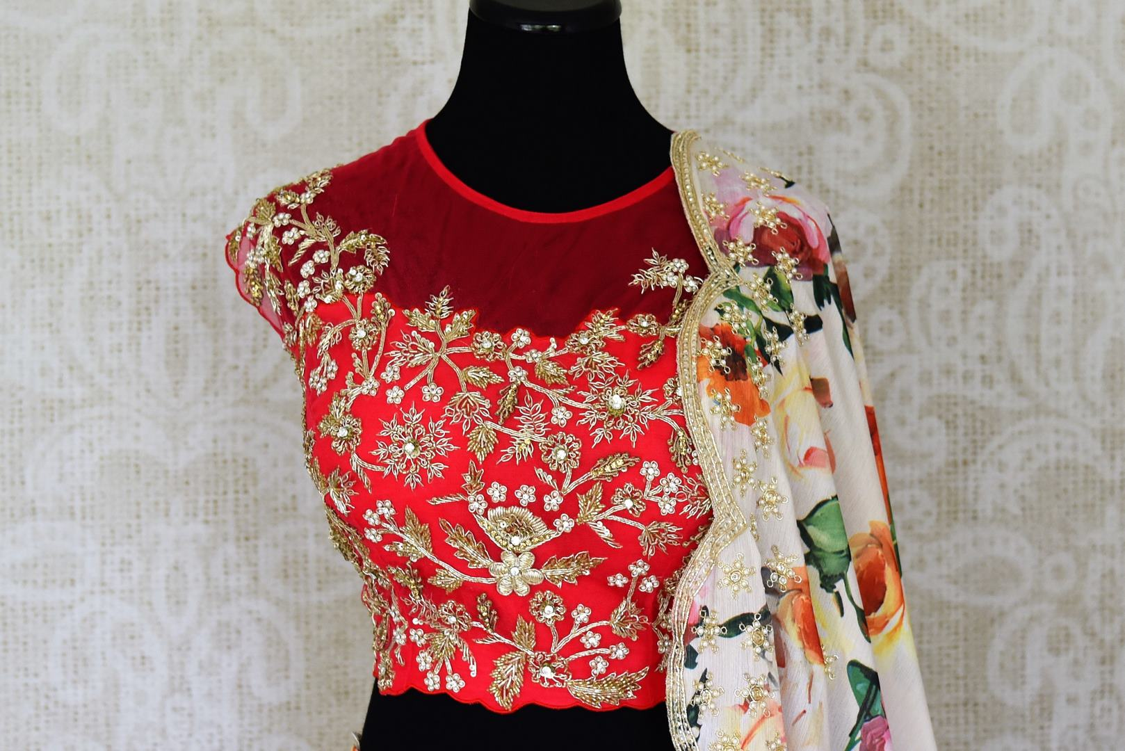 Buy cream and red floral print hand embroidered silk lehenga online in USA with dupatta. Step up your ethnic fashion game with exquisite variety of designer lehengas from Pure Elegance Indian clothing store in USA. Shop online.-front