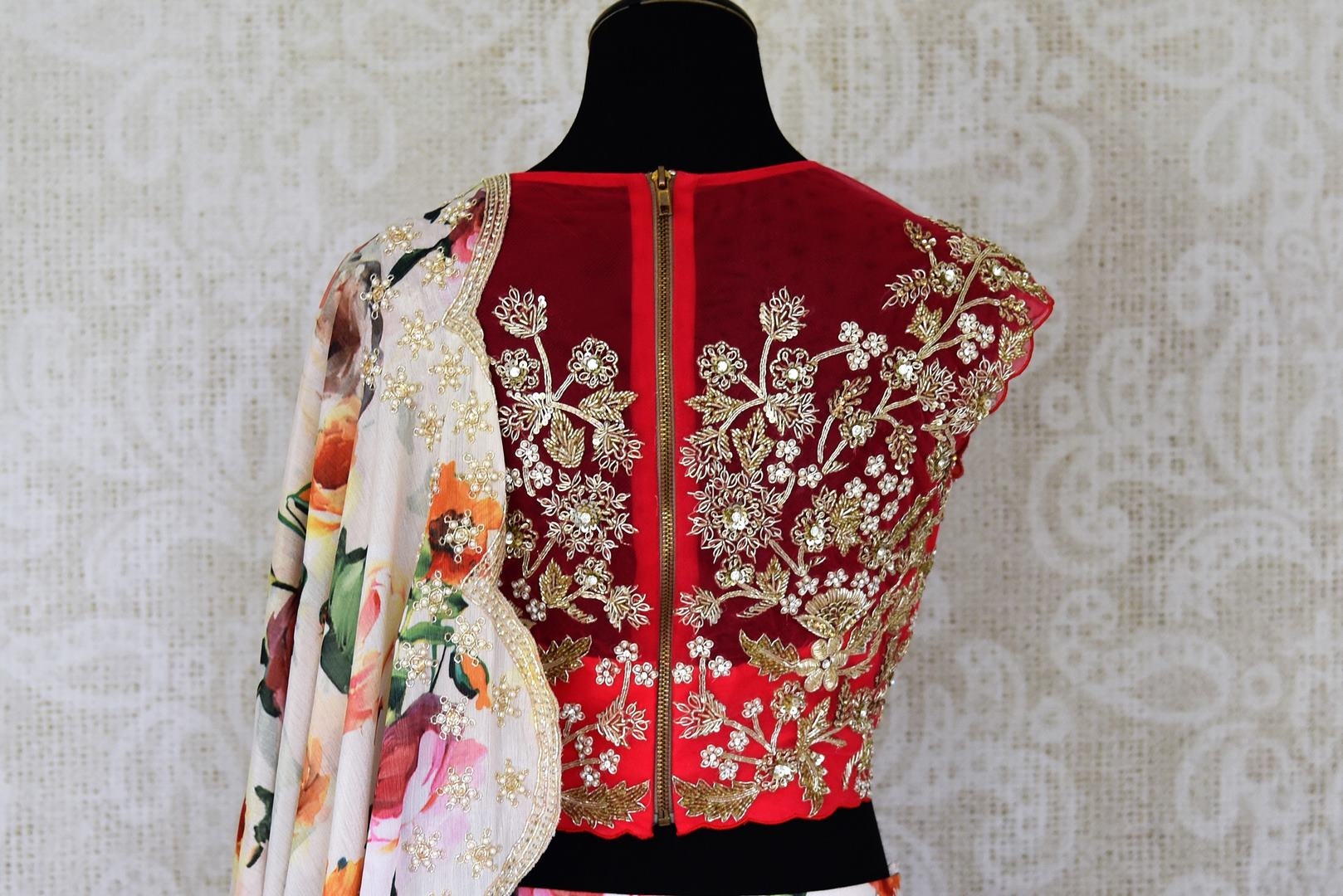 Buy cream and red floral print hand embroidered silk lehenga online in USA with dupatta. Step up your ethnic fashion game with exquisite variety of designer lehengas from Pure Elegance Indian clothing store in USA. Shop online.-back