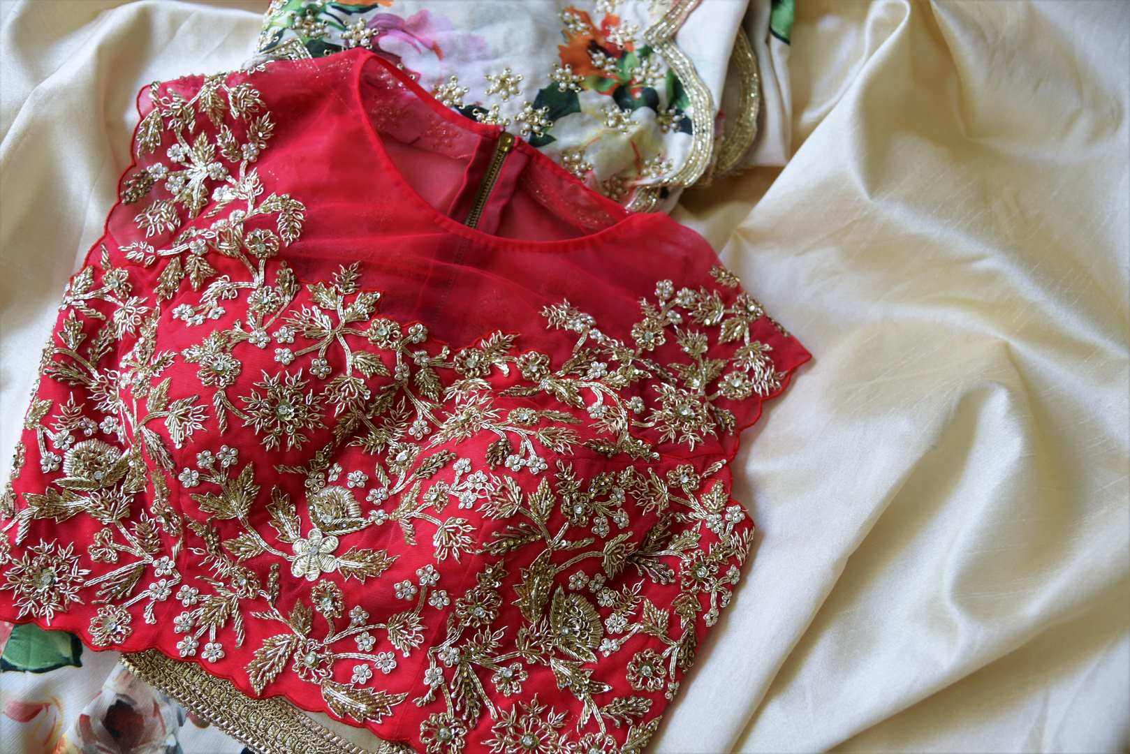 Buy cream and red floral print hand embroidered silk lehenga online in USA with dupatta. Step up your ethnic fashion game with exquisite variety of designer lehengas from Pure Elegance Indian clothing store in USA. Shop online.-details