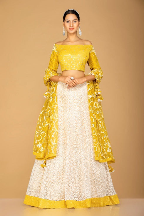 Shop beautiful yellow and white designer lehenga online in USA with dupatta. Gear up for the festive season with exquisite designer lehengas, Anarkali suits. Indian dresses from Pure Elegance Indian fashion store in USA. Shop online now.-full view