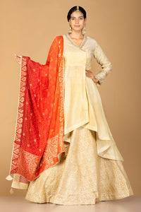 Shop cream tissue silk lehenga online in USA with red orange bandhani dupatta. Gear up for the festive season with exquisite designer lehengas, Anarkali suits. Indian dresses from Pure Elegance Indian fashion store in USA. Shop online now.-full view