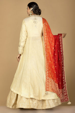 Shop cream tissue silk lehenga online in USA with red orange bandhani dupatta. Gear up for the festive season with exquisite designer lehengas, Anarkali suits. Indian dresses from Pure Elegance Indian fashion store in USA. Shop online now.-back