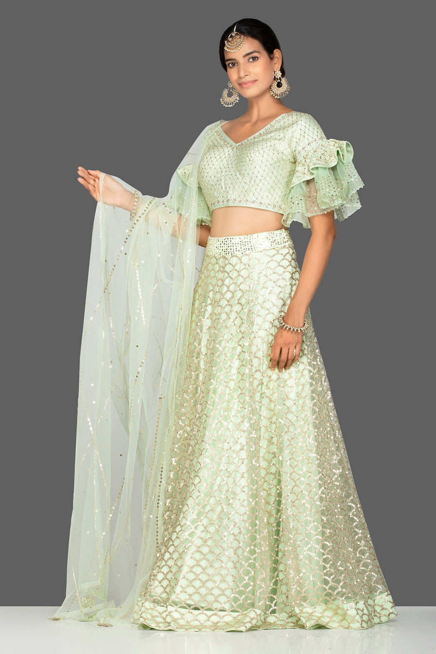 Shop beautiful mint green embroidered net lehenga online in USA with dupatta. Gear up for the festive season with exquisite designer lehengas, Anarkali suits. Indian dresses from Pure Elegance Indian fashion store in USA. Shop online now.-full view