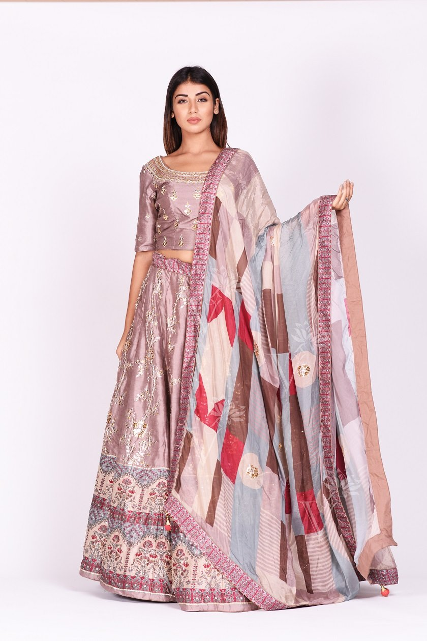 Shop gorgeous onion pink embroidered and printed silk lehenga online in USA. Make a stunning fashion statement at weddings and special occasions with an exquisite collection of designer Anarkali suits, traditional salwar suits, bridal lehengas from Pure Elegance Indian fashion store in USA. -full view