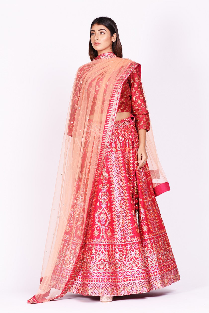 Buy beautiful pink embroidered silk designer lehenga online in USA with net dupatta. Make a stunning fashion statement at weddings and special occasions with an exquisite collection of designer Anarkali suits, traditional salwar suits, bridal lehengas from Pure Elegance Indian fashion store in USA. -full view
