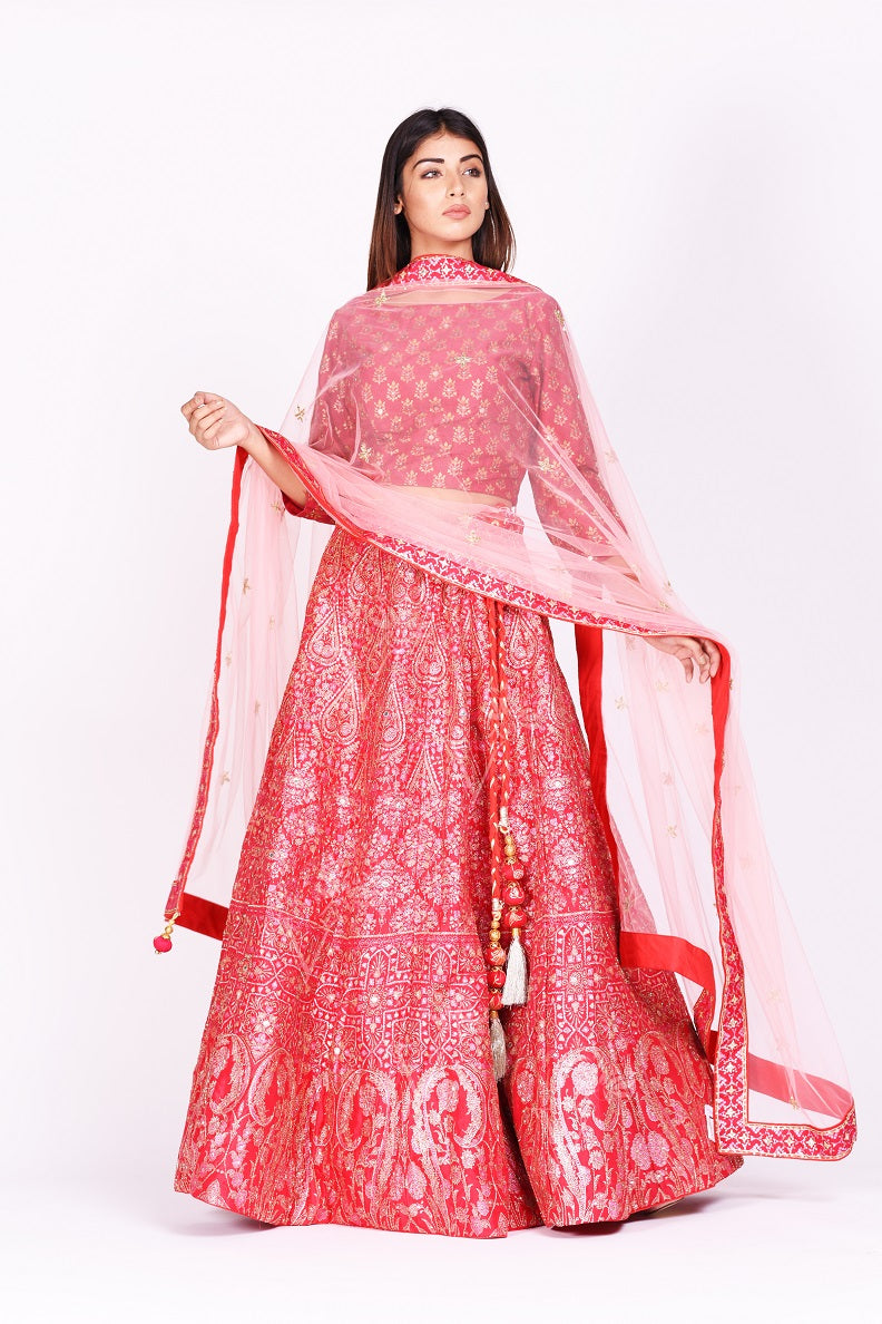 Buy beautiful pink embroidered silk lehenga with dupatta online in USA. Make a stunning fashion statement at weddings and special occasions with an exquisite collection of designer Anarkali suits, traditional salwar suits, bridal lehengas from Pure Elegance Indian fashion store in USA. -front