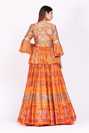 Buy orange embroidered and printed patola silk lehenga with dupatta online in USA. Make a stunning fashion statement at weddings and special occasions with an exquisite collection of designer Anarkali suits, traditional salwar suits, bridal lehengas from Pure Elegance Indian fashion store in USA. -back
