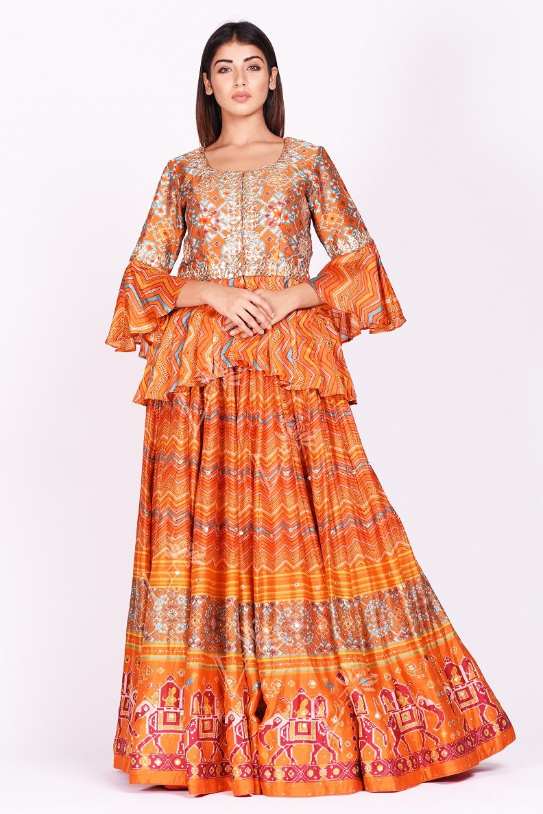 Buy orange embroidered and printed patola silk lehenga with dupatta online in USA. Make a stunning fashion statement at weddings and special occasions with an exquisite collection of designer Anarkali suits, traditional salwar suits, bridal lehengas from Pure Elegance Indian fashion store in USA. -without dupatta