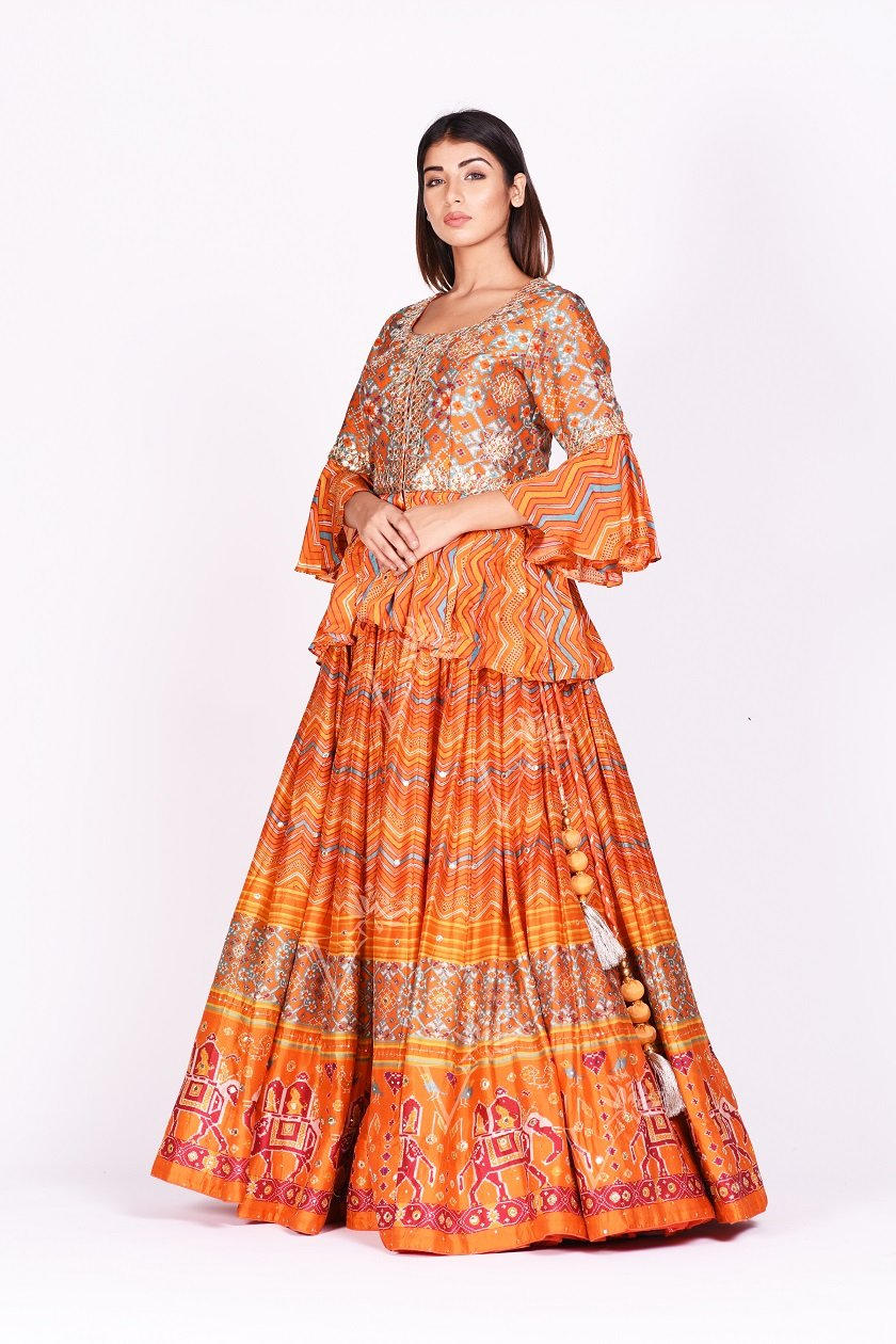Buy orange embroidered and printed patola silk lehenga with dupatta online in USA. Make a stunning fashion statement at weddings and special occasions with an exquisite collection of designer Anarkali suits, traditional salwar suits, bridal lehengas from Pure Elegance Indian fashion store in USA. -side without dupatta