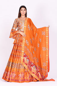 Buy orange embroidered and printed patola silk lehenga with dupatta online in USA. Make a stunning fashion statement at weddings and special occasions with an exquisite collection of designer Anarkali suits, traditional salwar suits, bridal lehengas from Pure Elegance Indian fashion store in USA. -full view