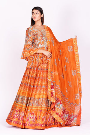 Buy orange embroidered and printed patola silk lehenga with dupatta online in USA. Make a stunning fashion statement at weddings and special occasions with an exquisite collection of designer Anarkali suits, traditional salwar suits, bridal lehengas from Pure Elegance Indian fashion store in USA. -front
