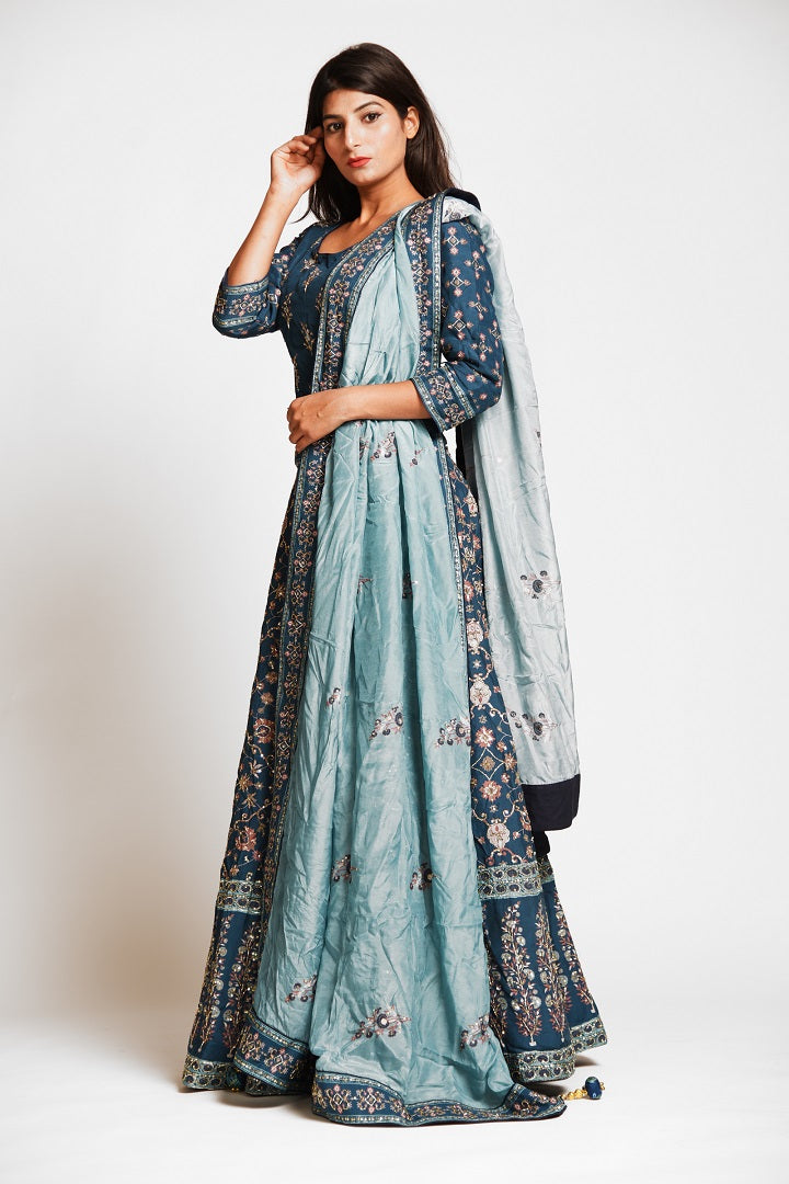 Buy beautiful teal color embroidered designer silk lehenga online in USA with dupatta. Make a stunning fashion statement at weddings and special occasions with an exquisite collection of designer Anarkali suits, traditional salwar suits, bridal lehengas from Pure Elegance Indian fashion store in USA. -side pose
