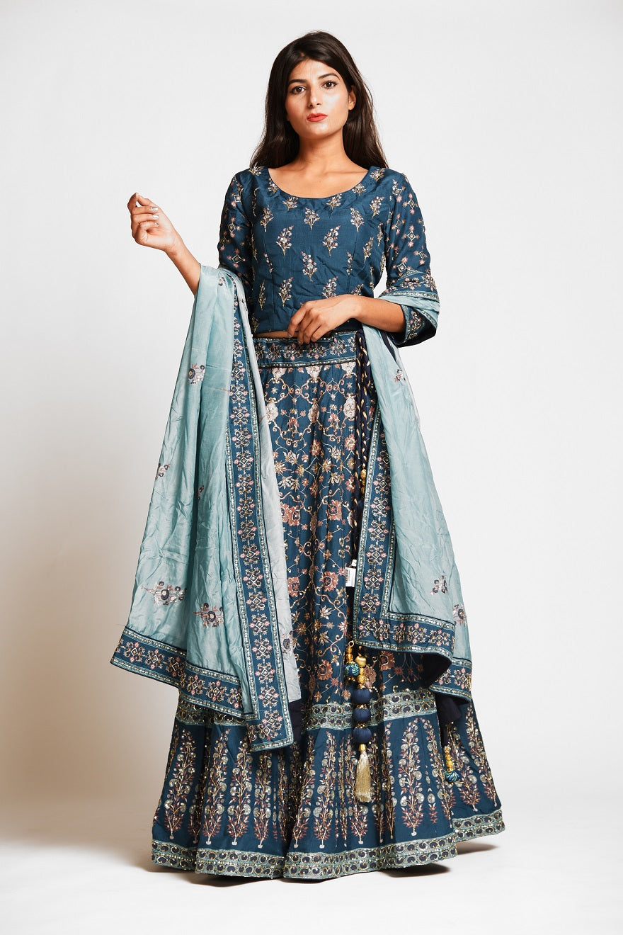 Buy beautiful teal color embroidered designer silk lehenga online in USA with dupatta. Make a stunning fashion statement at weddings and special occasions with an exquisite collection of designer Anarkali suits, traditional salwar suits, bridal lehengas from Pure Elegance Indian fashion store in USA. -full view