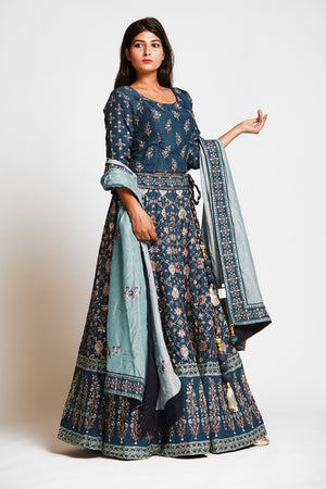 Buy beautiful teal color embroidered designer silk lehenga online in USA with dupatta. Make a stunning fashion statement at weddings and special occasions with an exquisite collection of designer Anarkali suits, traditional salwar suits, bridal lehengas from Pure Elegance Indian fashion store in USA. -side