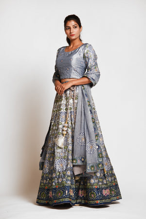 Shop stunning grey printed embroidered silk lehenga online in USA with dupatta. Elevate your traditional Indian style with exquisite designer lehengas, Anarkali suits, traditional salwar suits from Pure Elegance Indian clothing store in USA.-left side