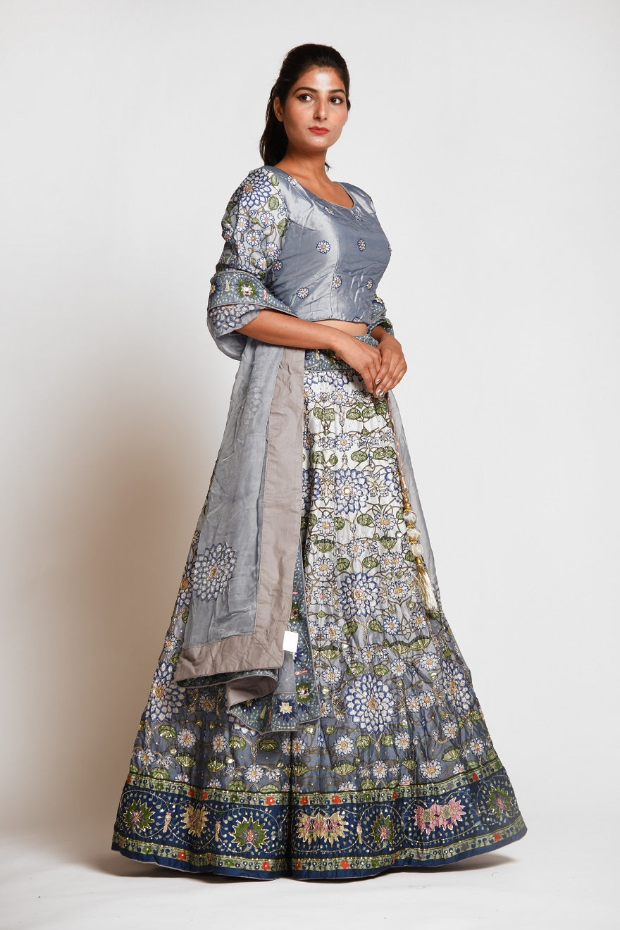 Shop stunning grey printed embroidered silk lehenga online in USA with dupatta. Elevate your traditional Indian style with exquisite designer lehengas, Anarkali suits, traditional salwar suits from Pure Elegance Indian clothing store in USA.-right side