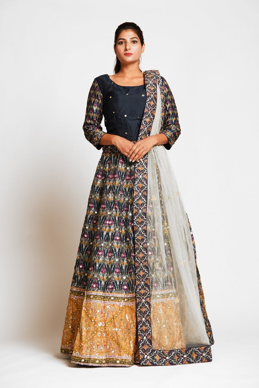 Buy beautiful black embroidered silk lehenga online in USA with mustard border and white net dupatta. Elevate your traditional Indian style with exquisite designer lehengas, Anarkali suits, traditional salwar suits from Pure Elegance Indian clothing store in USA.-full view