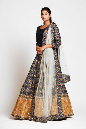 Buy beautiful black embroidered silk lehenga online in USA with mustard border and white net dupatta. Elevate your traditional Indian style with exquisite designer lehengas, Anarkali suits, traditional salwar suits from Pure Elegance Indian clothing store in USA.-side
